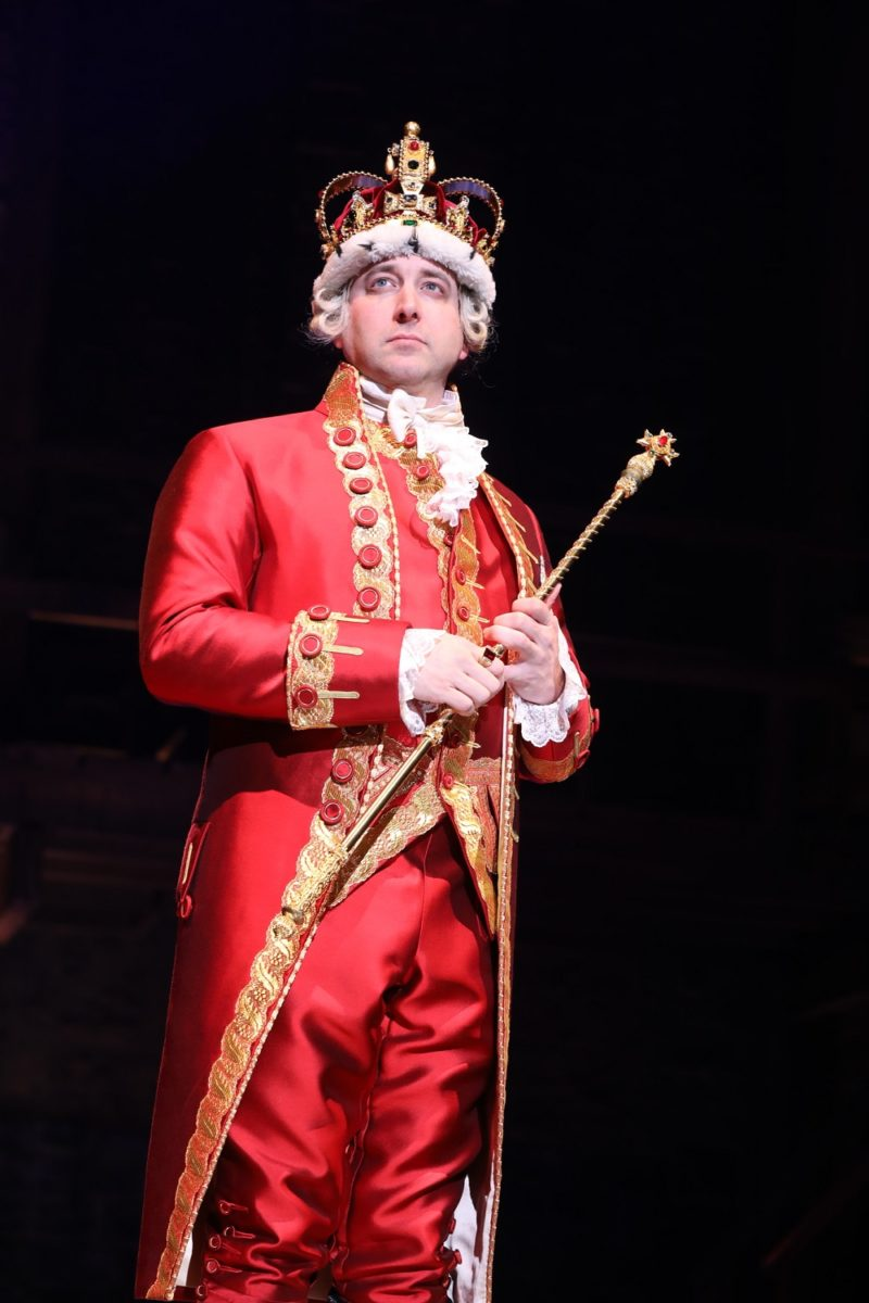 King George stands alone on stage, bewildered that he just lost the Revolutionary War.